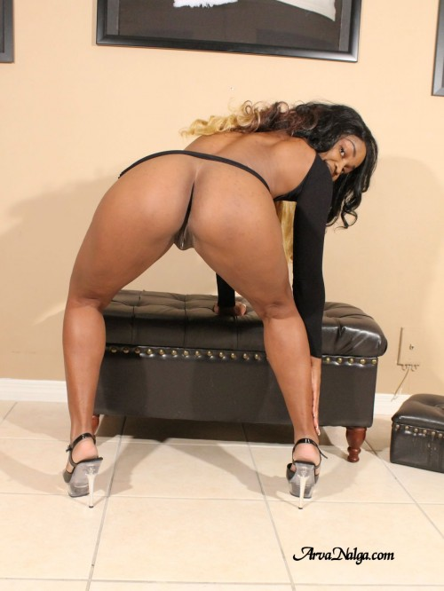 High heeled ebony milf spreads her legs to expose her creamy pussy and plump booty.