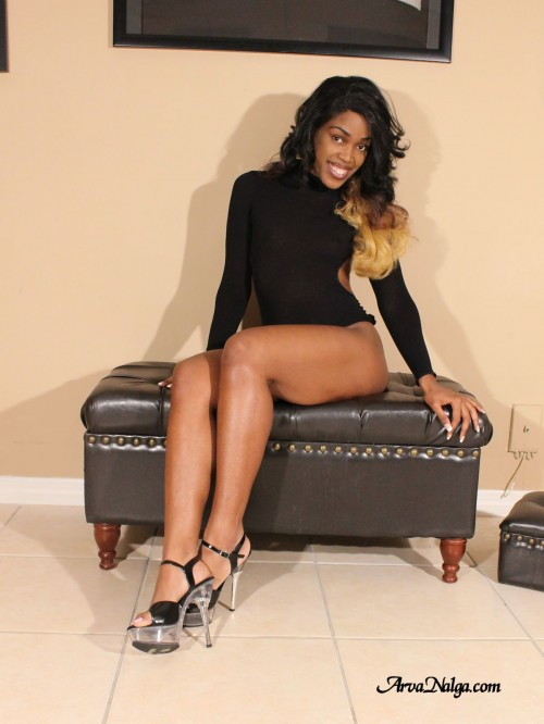 Ebony beauty, Arva Nalga, exposes her high heeled sexy legs.
