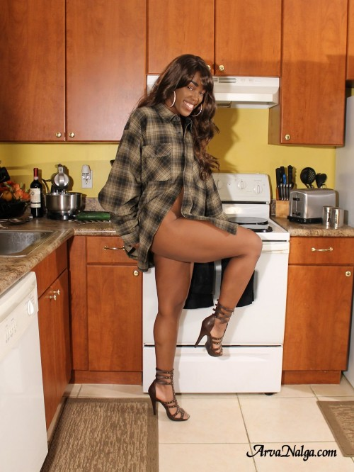 Arva Nalga in the kitchen showing off her high heels and sexy legs.