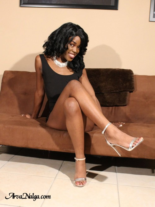 Sexy ebony glamour model and pornstar, Arva Nalga, shows her sexy legs in high heels.