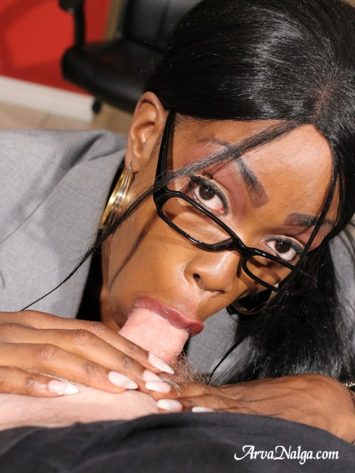 Black secretary gives good service by sucking her bosses white cock.
