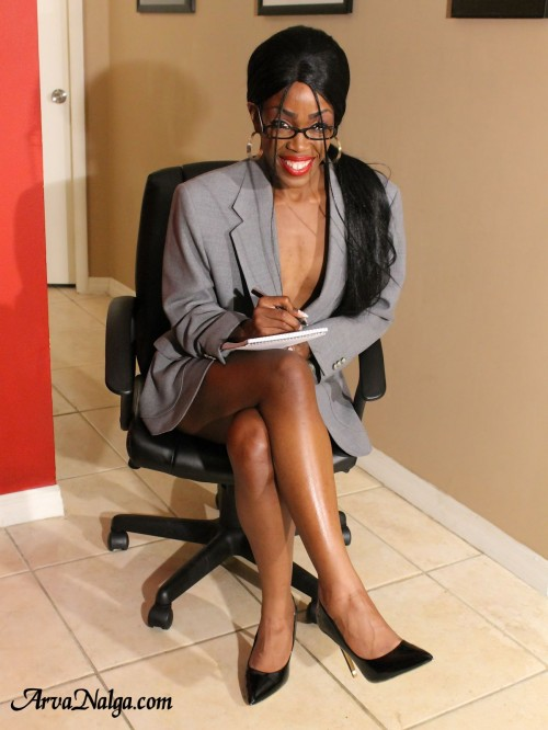 Ebony milf, Arva Nalga, shows leg in high heels and short skirt to get hired.