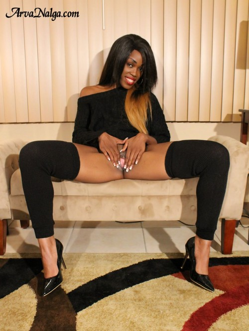 Glamorous, high heeled, ebony beauty spreading her pink pussy lips.