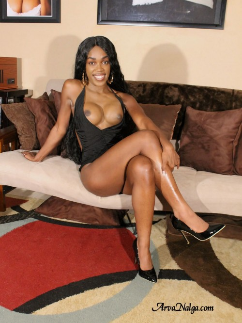 Ebony milf, mother and wife, Arva Nalga, shows off her big black tits and sexy legs.