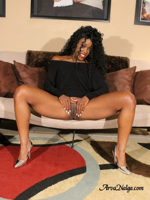 Ebony glamour babe wearing high heels opens her legs, and pussy.